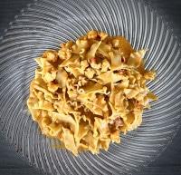 Hummerschwänze in Curry-Soße mit Pasta